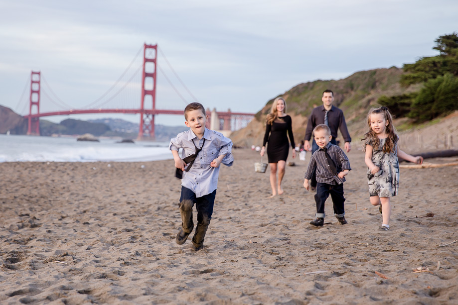 Happy Kids Running On The Baker Beach Near Golden Gate Bridge