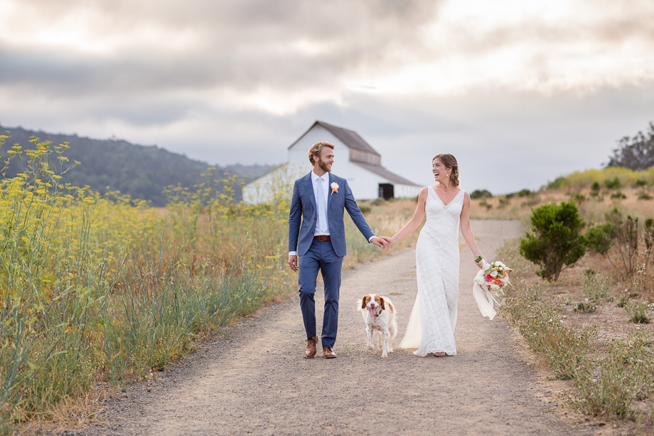 sweet wedding portrait on a quiet path of wild flowers at Giacomini Barn