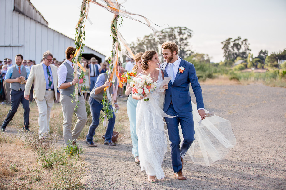 sweet candid photo during a wedding parade - Bay Area journalistic wedding photographer