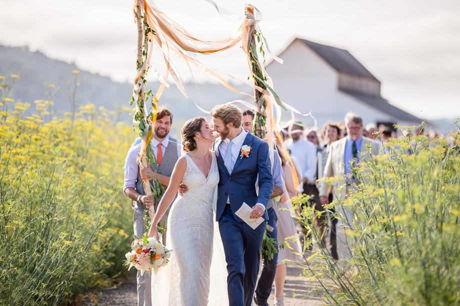 romantic wedding parade in a yellow wildflower field - Point Reyes Station wedding photographer